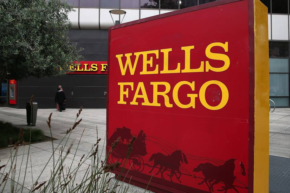 Like every other bank, Wells can't fight the superlow interest-rate environment brought about by the Fed. Above, a Wells Fargo sign in California.