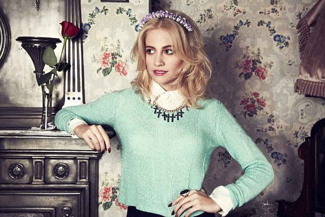 Green with envy: Pixie shows off some of the items from her new range
