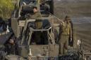 The Latest: Israel military beefs up presence on Gaza border