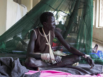 A man injured during tribal clashes that have erupted in Jonglei State. Ethnic conflict there is keeping at least 100,000 civilians from receiving urgently needed food and medical aid.