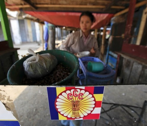 """A sticker of the """"969 movement"""" is seen at a shop in Minhla"""