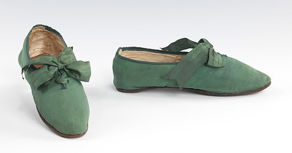 Green slippers with self-fabric bows, c. 1810-1829, at The Met.