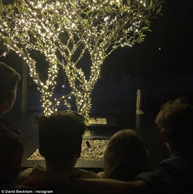 'Happy new year from our beautiful babies': The 40-year-old also shared a picture of their children - Cruz, 10, Brooklyn, 16, four-year-old Harper and Romeo, 13 - on Thursday
