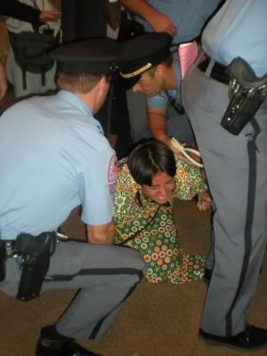 Protester resisting arrest at Wake County School Board meeting. Image courtesy Daily Tarheel