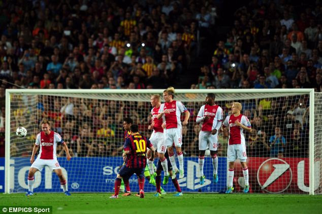Precision: Messi bends in a long-range free-kick for his first goal of the evening