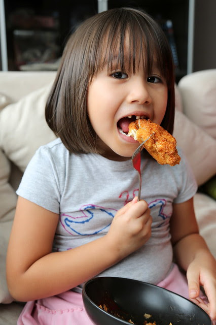 Jolie enjoying the chicken
