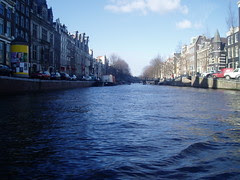 Canal in Amsterdam looked in a boat