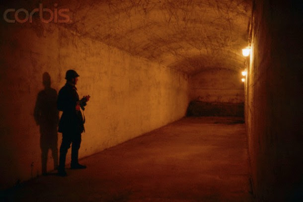 A Romanian soldier guarding a passageway in the underground tunnel used by notorious Romanian secret police, or , in the House of the People days after the December 1989 uprising, which marked the end of dictator Nicolae Ceausescu's rule. In a brief but violent revolution that spread from Timisoara to Bucharest, during which more than 1,200 people died, Ceausescu and his regime were overthrown and the dictator and his wife Elena summarily executed by firing squad.