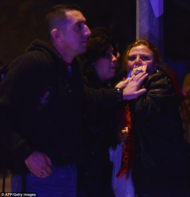 Concern: People react near the site of an explosion after a car bomb targeted Turkish military in Ankara, killing at least 18 people and injuring at least 45 others