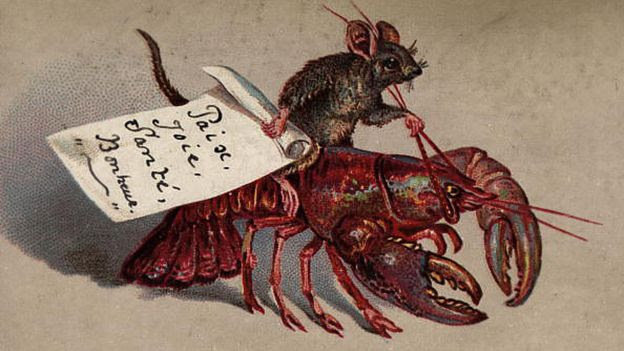 Old card of a mouse riding a lobster, 1880 The card wishes the recipient 'Paix, Joie, Sante, Bonheur' or 'Peace, Joy, Health and Happiness'.