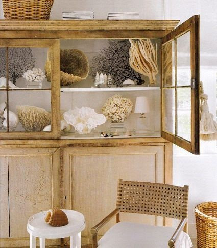 Lovely Display of coral,etc. in this beautiful cabinet in a beach house in Miami by Cindy Christensen. Love the Design!