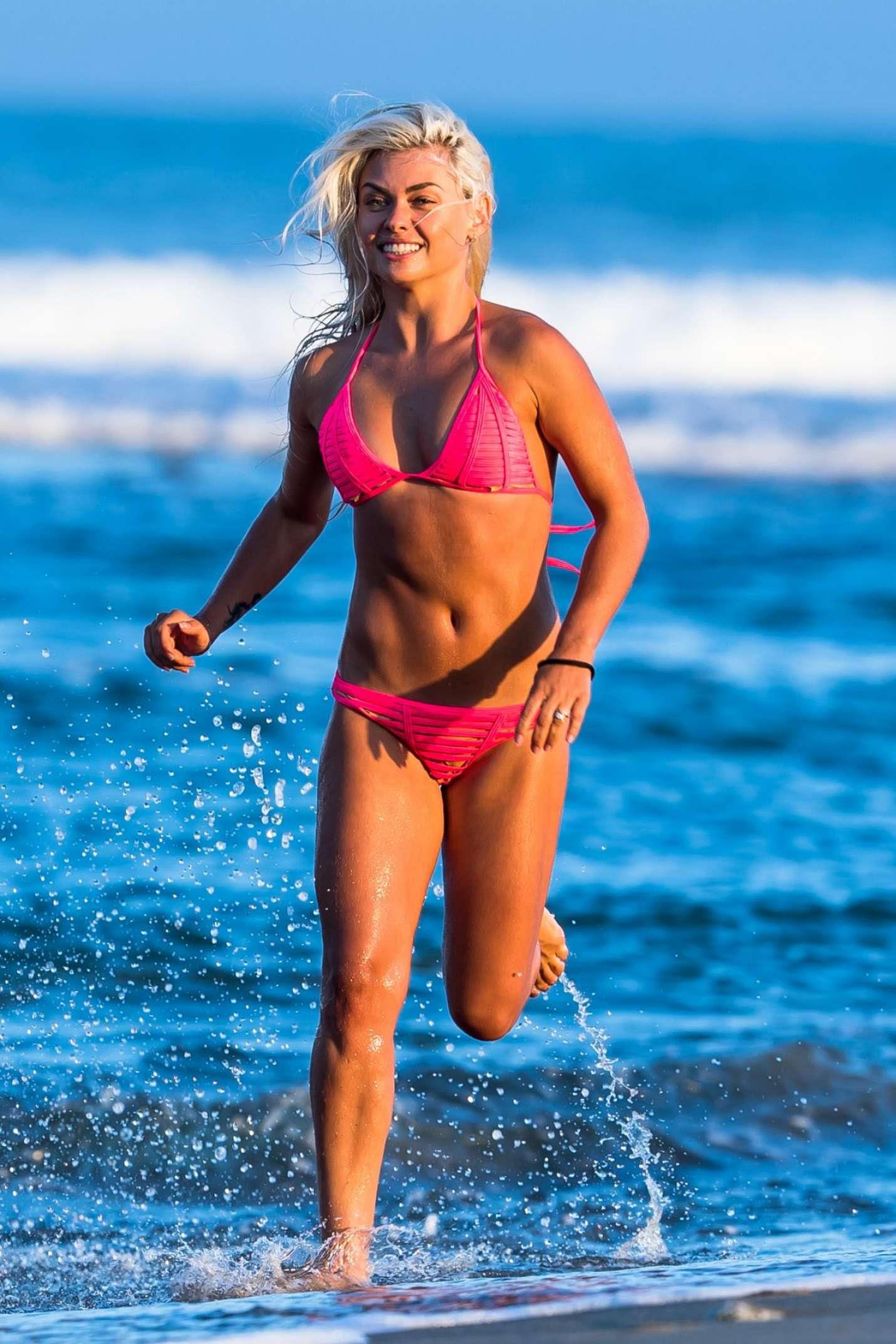 Oksana Platero in Pink Bikini on the beach in Malibu