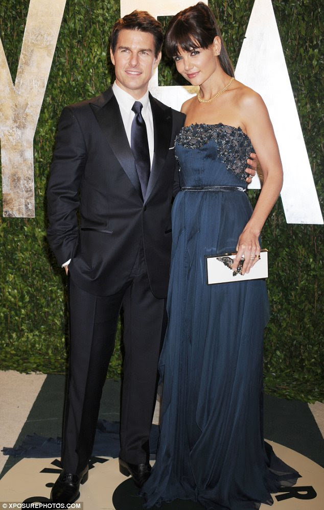 Hopelessly devoted: Tom, pictured with Katie Holmes in February, also used the Playboy interview to gush about his love for his wife