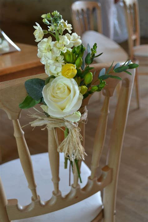 End of aisle chair flowers containing rose, stock, freesia