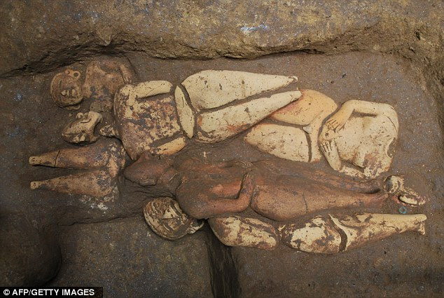 Past times: Ceramic dolls found in the royal tomb of the Mayan king discovered at the Tak'alik Ab'aj dig