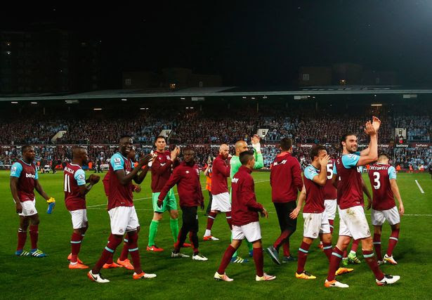 West Ham players applaud the crowd
