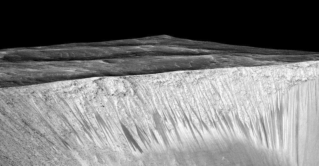 "Dark narrow streaks, called ""recurring slope lineae,"" emanate from the walls of Garni Crater on Mars"