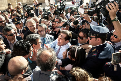 Crocetta mobbed by protesters and members of the media in Syracuse.