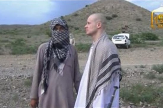 Traitor Bergdahl during Taliban exchange. Not looking too malnourished to me.