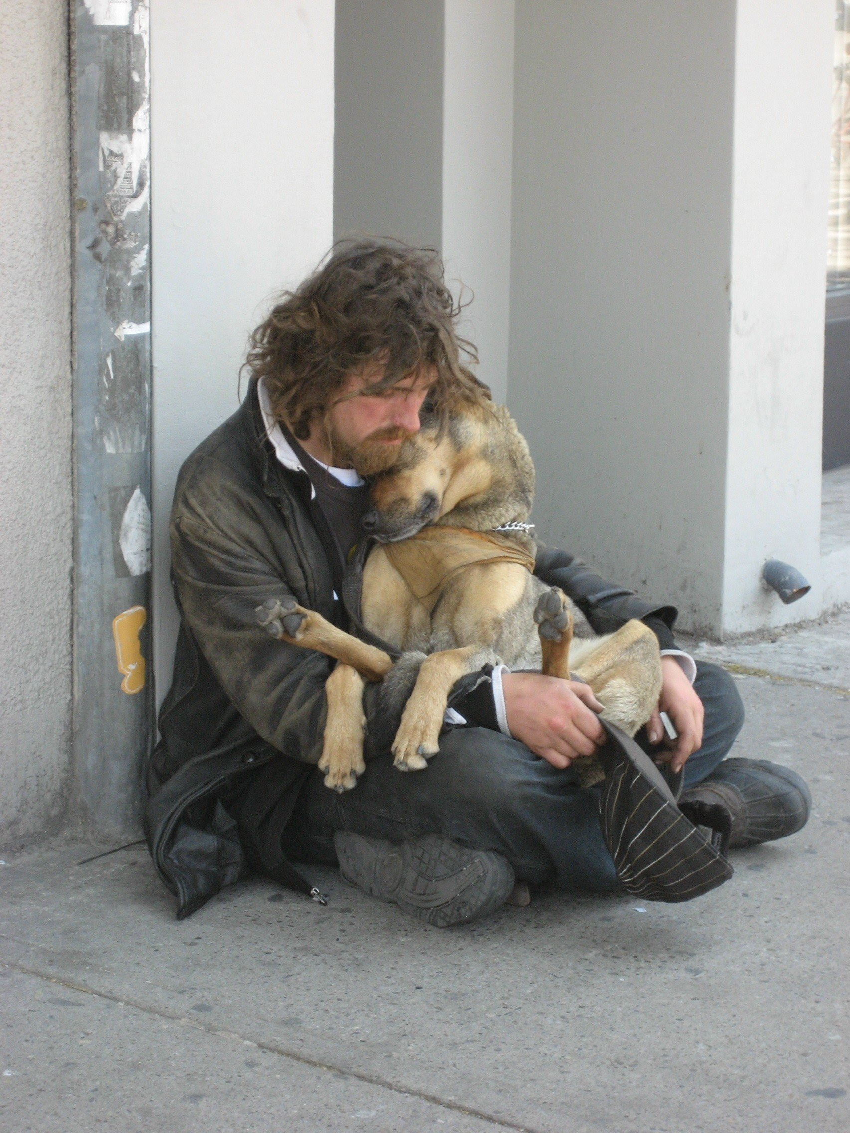 http://rebirth22.files.wordpress.com/2007/06/homeless-cuddling-dog-by-kirsten-bole-100-dpi.jpg