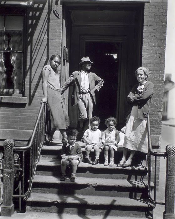Jay Street, No. 115, Brooklyn. Three generations of African Americans on stoop of brick home with iron rails on steps.