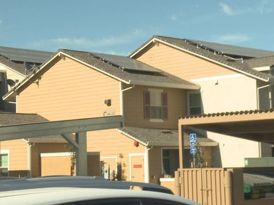 635712312356572653-solar-power-apartments
