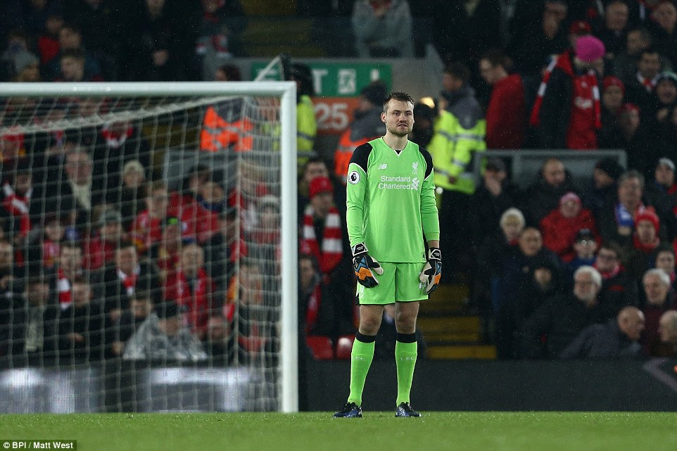 Mignolet looks dejected after conceding the opening goal during the Premier League match at Anfield on Tuesday evening