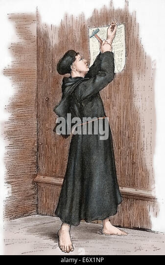 Martin Luther (1483-1546). German reformer. Luther hanging his 95 theses in Wittenberg, 1517. Engraving. Colored. - Stock Image
