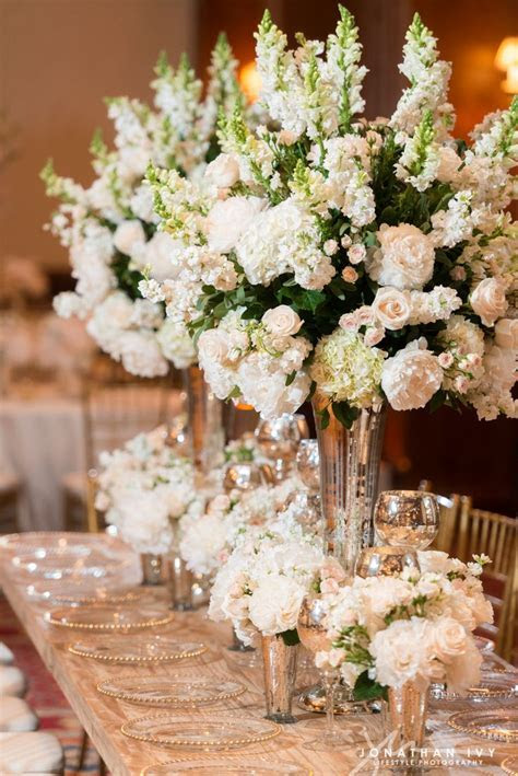 Large floral arrangements of white stock, peonies, and