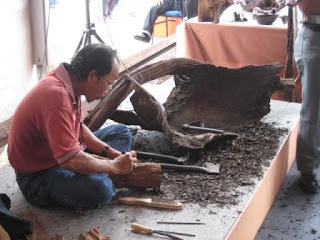 A wood carver busy at work