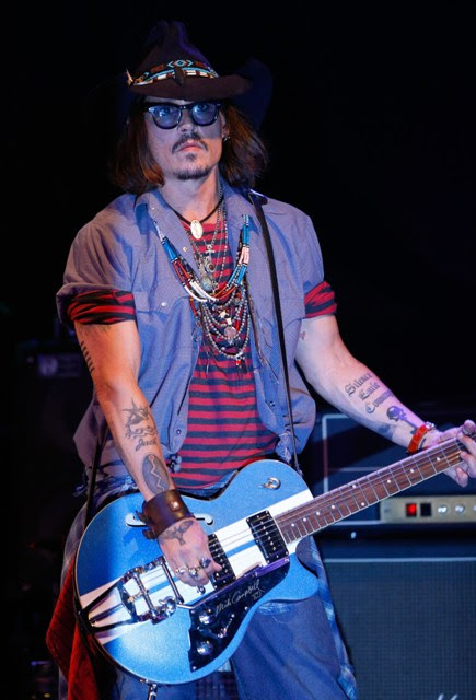 Johnny Depp performs as a guest guitarist onstage during the first ever Jameson Petty Fest West at El Rey Theatre