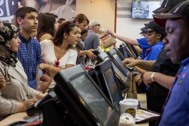 Customers are served at a McDonald's in Times Square in New       York July 23, 2015. REUTERS/Brendan McDermid