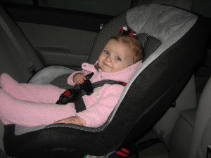 Proof that she's a big girl, in her big girl car seat and a bow without a headband!