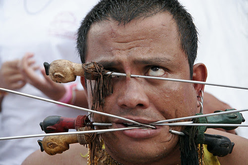 Man with pierced face at Kathu shrine, Phuket