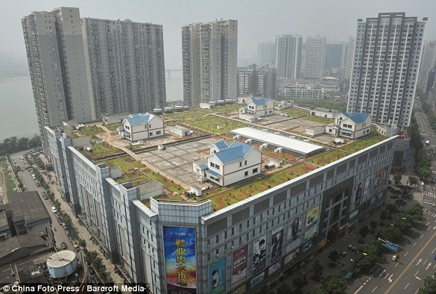 A roof with a view: These amazing villas have been built on top of the eight-storey Jiutian International Plaza in the Chinese city of Zhuzhou