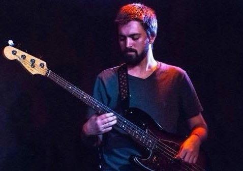 Spencer Golvach playing his bass guitar.