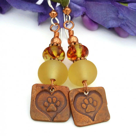 Unique dog paw print and heart artisan earrings.