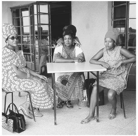 Three women relax in Tanzania. Successful women from ruling families enjoy many of the same privileges as men.