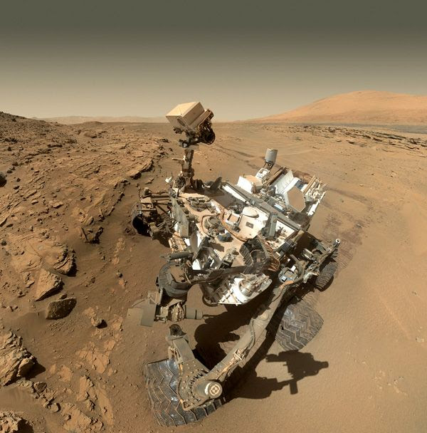 A self-portrait of NASA's Curiosity Mars rover, taken with a camera on her robotic arm in late April of 2014.