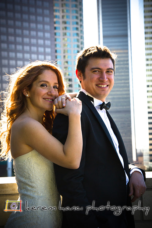 Downtown behind and a whole life together in front of them, the couple smiles.