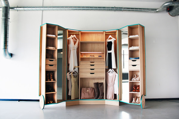 A Compact Walk-in Closet With Tons Of Hidden Storage