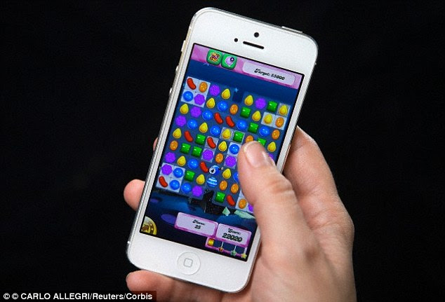 A man tore a tendon in his thumb after playing the game Candy Crush Saga on his phone for weeks - but reported he felt no pain at all (file photo)