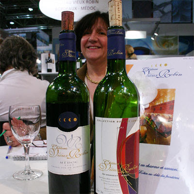 Maryse Roba, owner of Château Vieux Robin with two of her 2005s: the Cuvée Bois de Lunier and the Collection Bois de Lunier