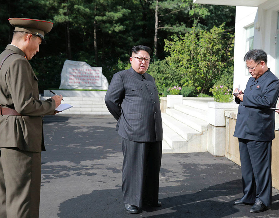 North Korean leader Kim Jong-Un gives field guidance during a visit to the Chemical Material Institute of the Academy of Defense Science in this undated photo released by North Korea's Korean Central News Agency (KCNA) in Pyongyang