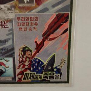 Poster in North Korea classroom. Photo: DEF cc0