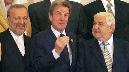 Bernard Kouchner et son homologue syrien Walid al-Muallem. (Marwan Naamani / AFP)