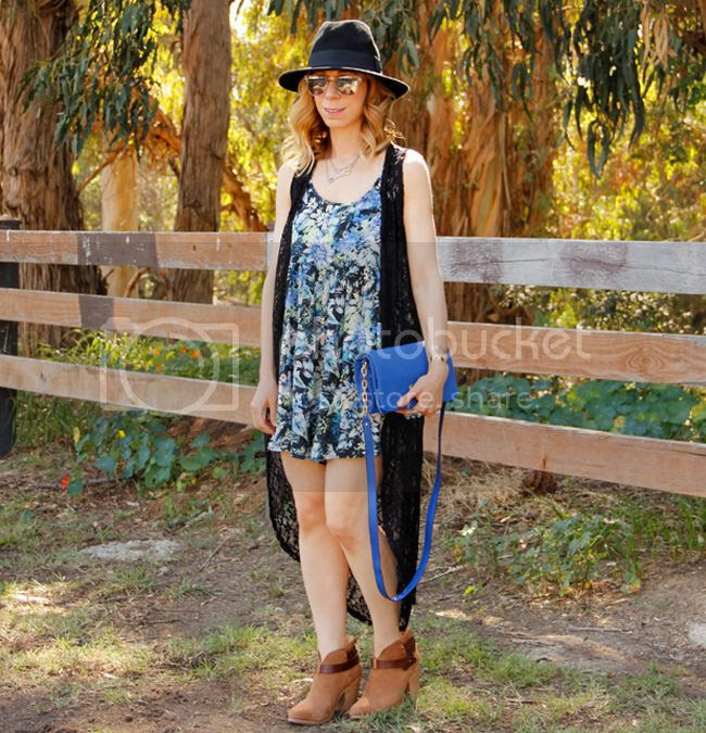 Fashion blogger The Key To Chic wears a tropical print romper and lace maxi vest from Kohl's with Rag & Bone Harrow boots.