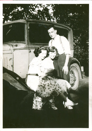 two girls, one guy and a car