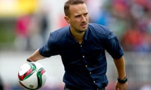 The England coach Mark Sampson returns the ball during England's narrow defeat by France in their opening game.