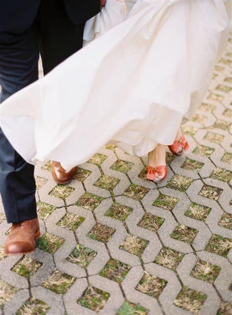 airplane hanger wedding bride groom coral heels shoes fall